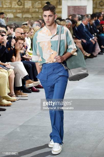 Hero FiennesTiffin walks the runway during Salvatore Ferragamo fashion show in Piazza della Signoria during Pitti Immagine Uomo 96 on June 11 2019 in...