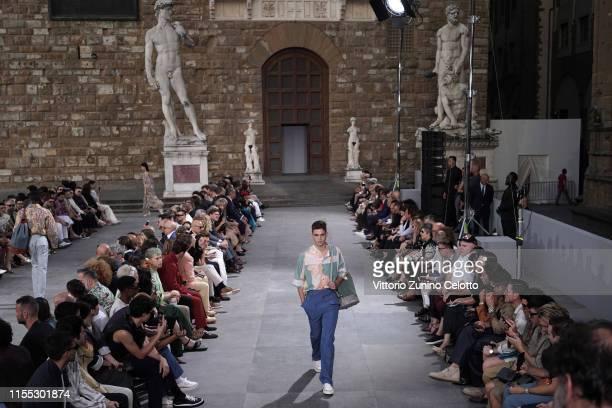 Hero Fiennes-Tiffin walks the runway during the attends Salvatore Ferragamo fashion show in Piazza della Signoria during Pitti Immagine Uomo 96 on...