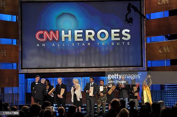 "Hero Magnus MacFarlane-Barrow of ""Mary's Meals"", CNN Heroes host Anderson Cooper, CNN Hero Susan Burton of ""A New Way of Life Reentry Project"", CNN..."