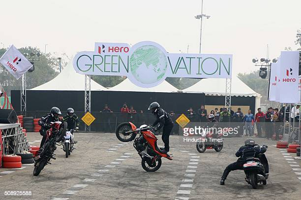 Hero MotoCorp bikers perform stunt at Auto Expo 2016 on February 7 2016 in Greater Noida India The 13th edition of the Delhi Auto Expo kicked off at...
