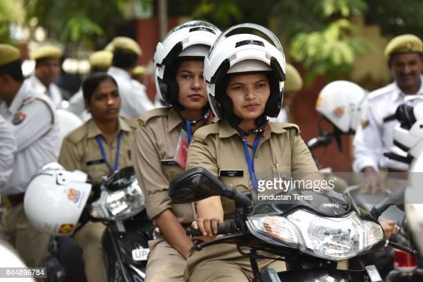 Hero MotoCorp presents 20 new Hero Duet scooters and 30 new Hero Achiever motorcycles to Gautam Budh Nagar police officers under the projects –...