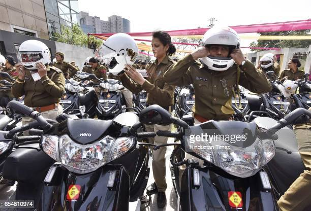 Hero MotoCorp presents 50 new scooters to Gurugram Women Police officers under project 'Sakhi' on March 18 2017 in Gurgaon India
