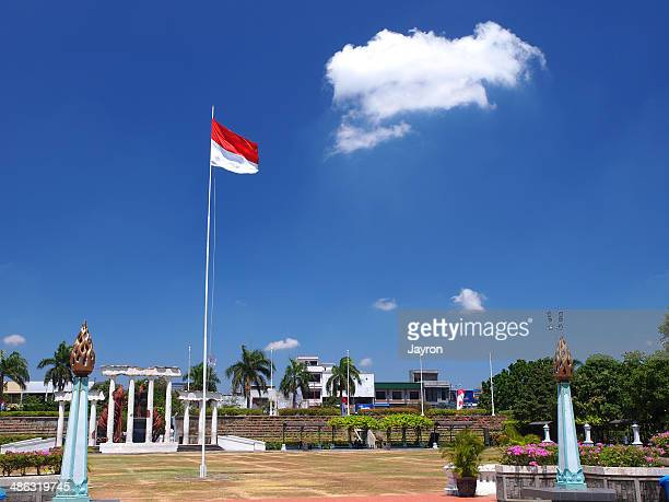 hero square in surabaya - indonesia flag stock photos and pictures