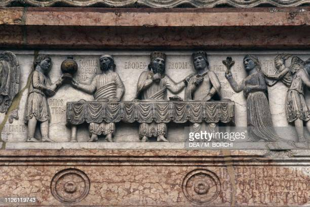 Herod's banquet relief on the architrave of the North door or Portal of the Virgin Baptistery Parma EmiliaRomagna Italy 12th13th century