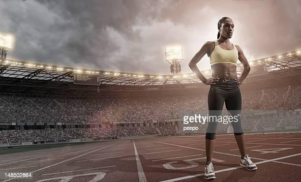 Heroic Athlete Standing on Running Track