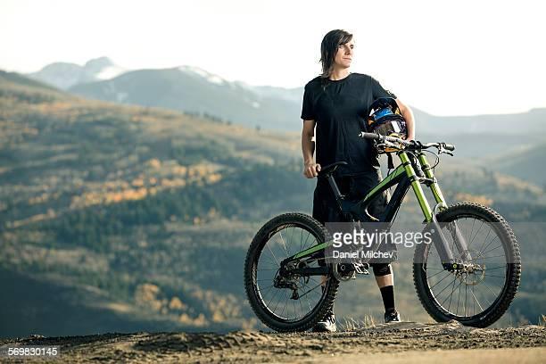 Heroic portrait of a female mountain bike racer.