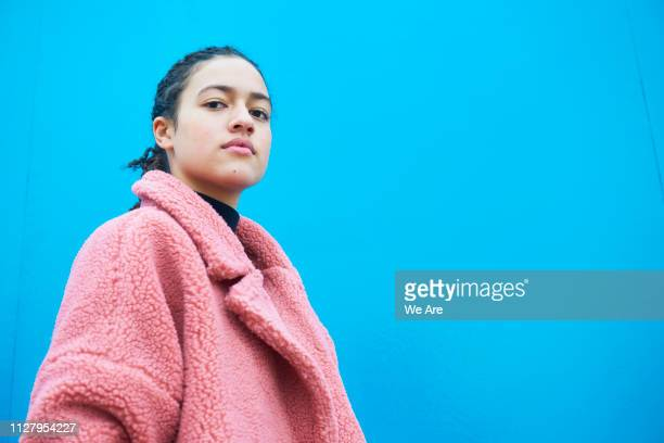heroic portrait of young woman in fur coat. - hero and not superhero stock pictures, royalty-free photos & images