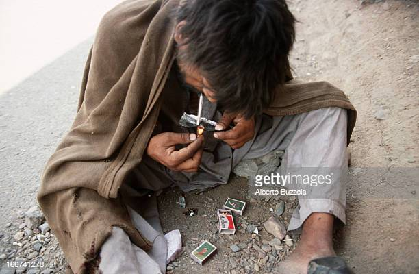 A heroin addict inhales heroin from a silver papermade tray Heroin is readily available in the nearby tribal land at a very cheap price