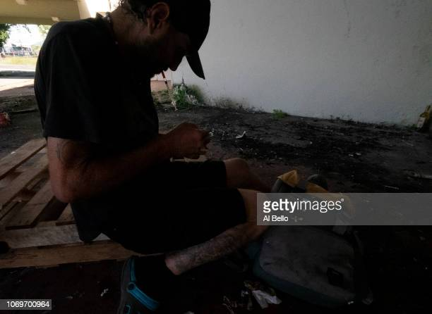 A heroin addict prepares to shoot up outside of the Yldefonso Sola Morrales Stadium in Caguas Puerto Rico on November 14 2018 It was of the home of...