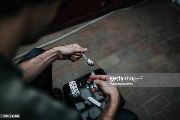 heroin is ready - heroin addict arm stock photos and pictures