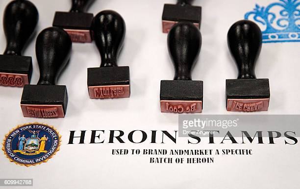 Heroin stamps used to brand a specific batch of the drug are displayed before a press conference regarding a major drug bust at the office of the New...
