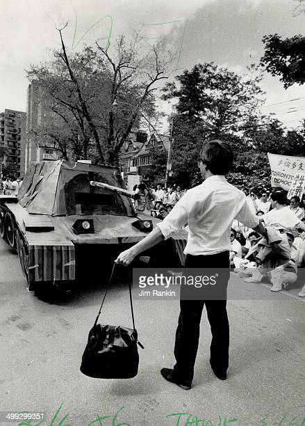Heroism reenacted A demonstrator stands before a replica of a tank yesterday in front of the Chinese consulate celebrating the heroism of a man last...