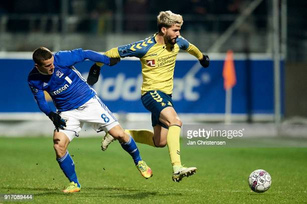 Herolind Shala of Lyngby BK and Anthony Jung of Brondby IF compete for the ball during the Danish Alka Superliga match between Lyngby BK and Brondby...