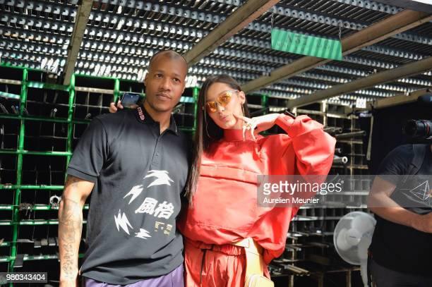 Heron Preston and Bella Hadid Bella Hadid wearing the Nike Tailwind HP performance sunglasses are seen backstage during the Heron Preston Menswear...