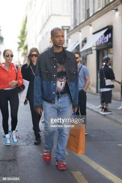 Heron Preston is seen on the street during Paris Men's Fashion Week S/S 2019 wearing denim jacket with jeans on June 22 2018 in Paris France