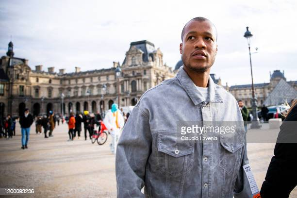 Heron Preston, wearing a grey denim jacket, is seen outside the Off-White show during the Paris Fashion Week - Menswear F/W 2020-2021 on January 15,...