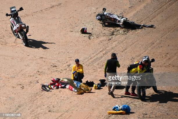 TOPSHOT Hero's Portuguese motorbike rider Paulo Goncalves is attended by medical staff after a crash during the Stage 7 of the Dakar 2020 between...