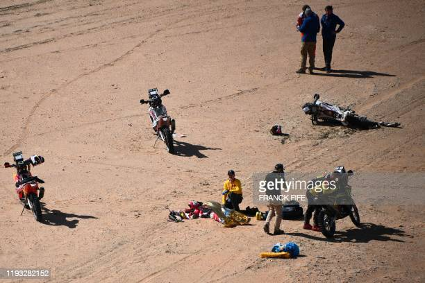 Hero's Portuguese motorbike rider Paulo Goncalves is attended by medical staff after a crash during the Stage 7 of the Dakar 2020 between Riyadh and...