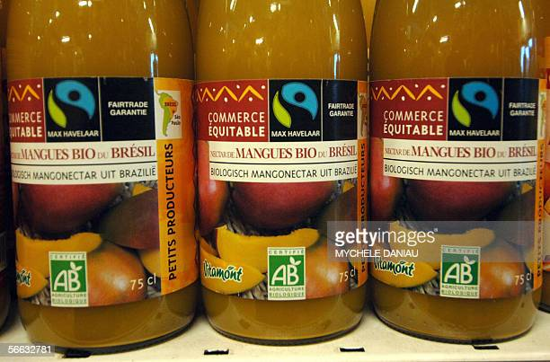 TO GO WITH THE AFP STORIES ON BIO AND FAIR TRADE Picture of bottles of mango juice coming from organic production and fair trade on sale in a...