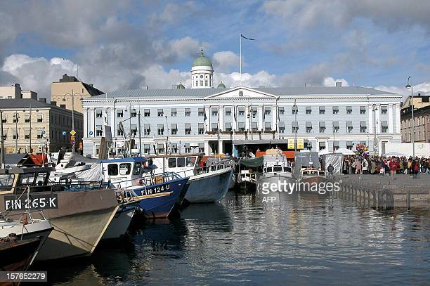 Herring boats are docked in front of the Finnish capital's famous market place for the 261st annual Baltic Herring Market In the background are...