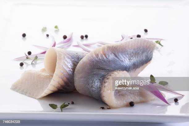 Herring fillets with red onions