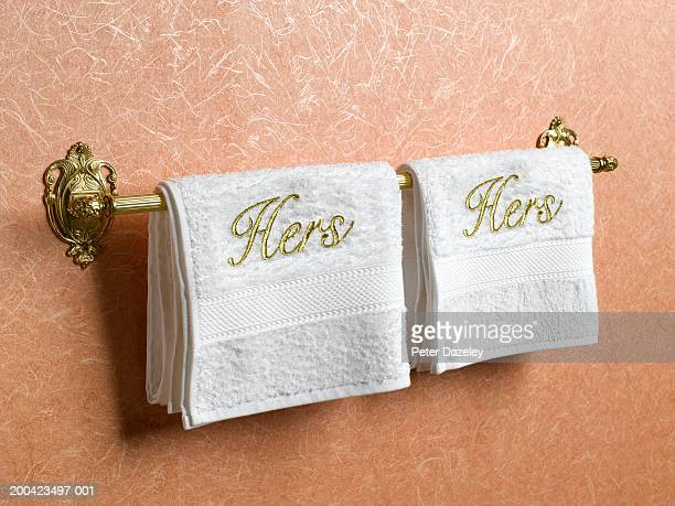 Hers and hers towels on towel rail