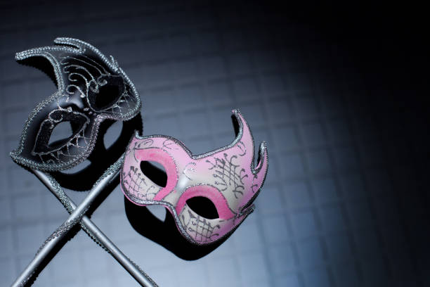 hers and his masks on black background - masquerade ball stock pictures, royalty-free photos & images
