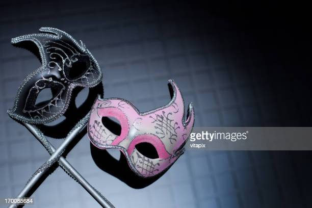Hers and His Masks on Black Background