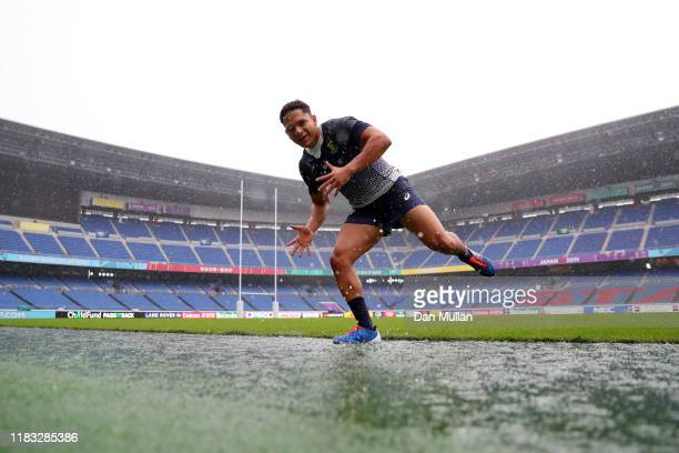 Herschel Jantjies of South Africa jumps in a puddle as he leaves the field during the South Africa Captain's run ahead of their 2019 Rugby World Cup...