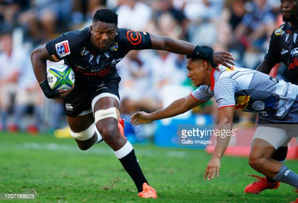 Herschel Jantjies of the DHL Stormers looks to tackle Sikhumbuzo Notshe of the Cell C Sharks during the Super Rugby match between Cell C Sharks and...