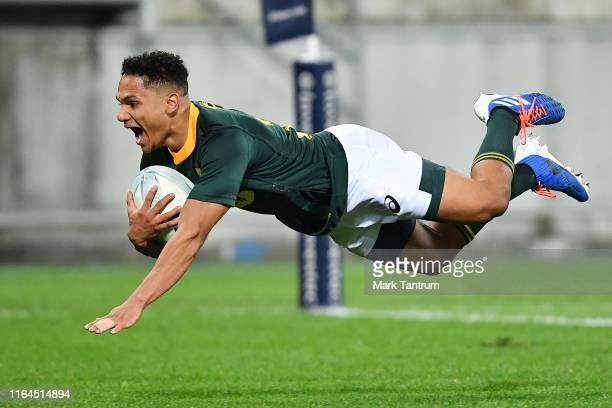 Herschel Jantjies of the Springboks scores during the 2019 Rugby Championship Test Match between New Zealand and South Africa at Westpac Stadium on...