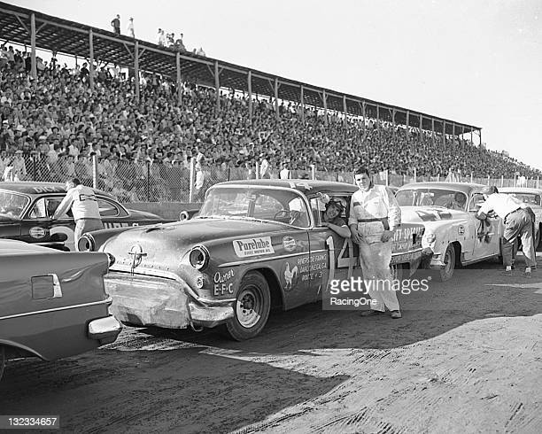 Herschel McGriff leans out of his Frank Christianowned Air Lift Oldsmobile before the start of the NASCAR Cup race at North Wilkesboro Speedway The...