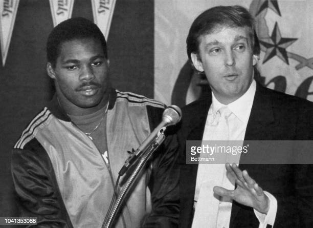 Herschel Walker NJ Generals Running Back looks on as Donald Trump JJ Generals Owner makes the announcement of a new contract for Herschel Walker...