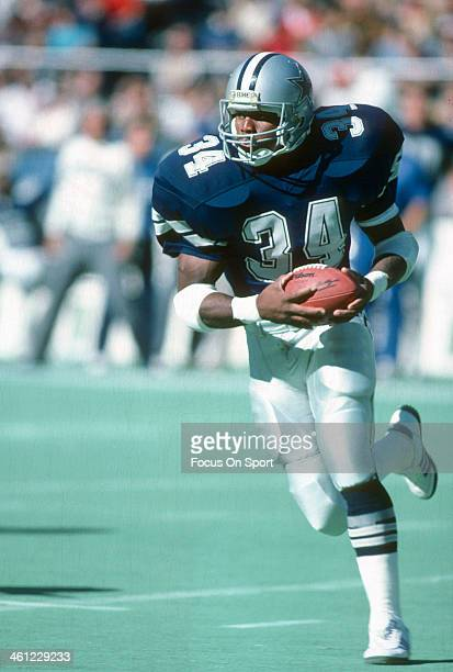 Herschel Walker of the Dallas Cowboys carries the ball against the Philadelphia Eagles during an NFL football game October 23 1988 at Veterans...
