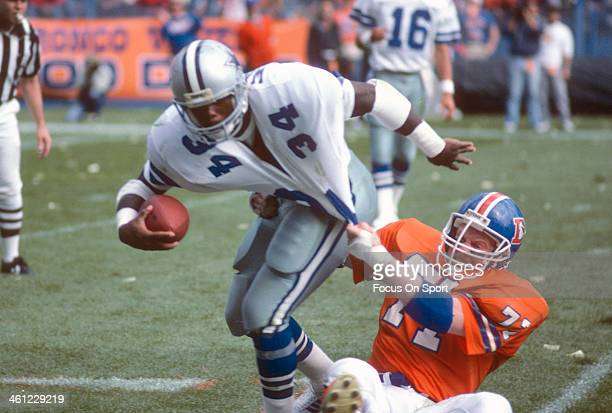 Herschel Walker of the Dallas Cowboys gets tackled by Greg Kragen of the Denver Broncos during an NFL football game October 5 1986 at Mile High...