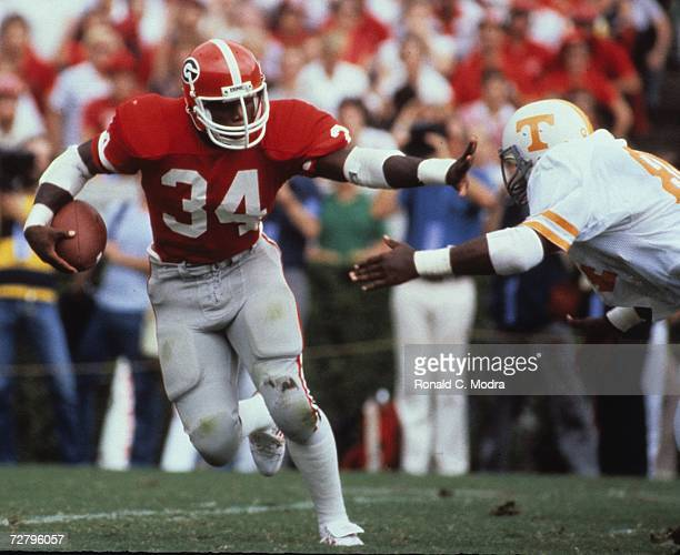 Herschel Walker of the Georgia Bulldogs carries the ball against the Tennessee Volunteers on September 5 1981 in Athens Georgia