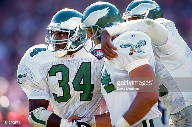 Herschel Walker of the Philadelphia Eagles celebrates with teammates Mark Bavaro and Randall Cunningham during a National Football League game...