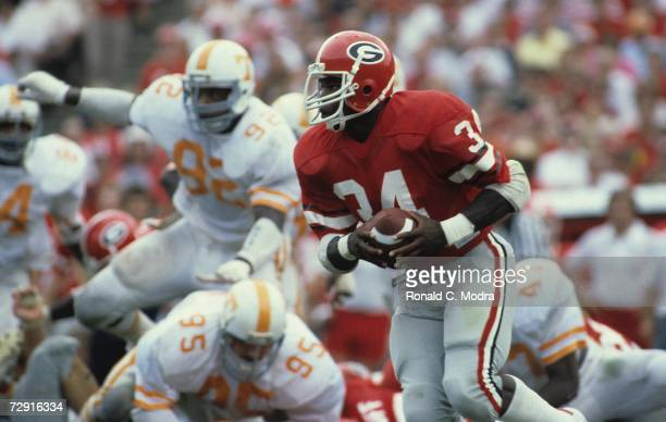 Herschel Walker of the University of Georgia Bulldogs carries the ball during a game against the University of Tennessee Volunteers on September 5...