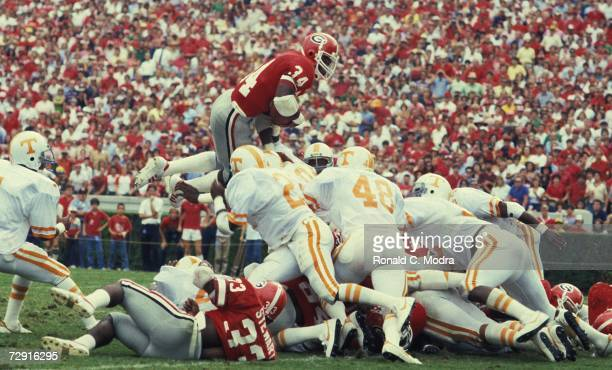 Herschel Walker of the University of Georgia Bulldogs goes over the top for a touchdown during a game against the University of Tennessee Volunteers...