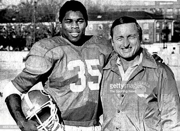 Herschel Walker of the University of Georgia Bulldogs UPI's Back of the Year by United Press International stands with head coach Vince Dooley UPI's...