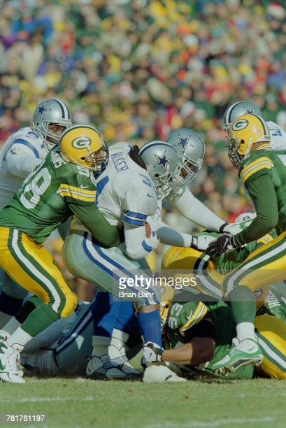 Herschel Walker Running Back for the Dallas Cowboys is tackled by Gabe Wilkins Linebacker for the Green Bay Packers whilst running the ball during...