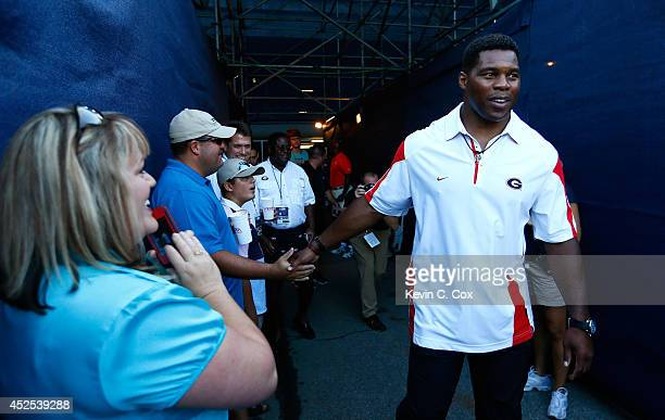 Herschel Walker walks onto Stadium court for the coin toss prior to the match between Nathan Pasha and Lukas Lacko of Slovakia during the BBT Atlanta...