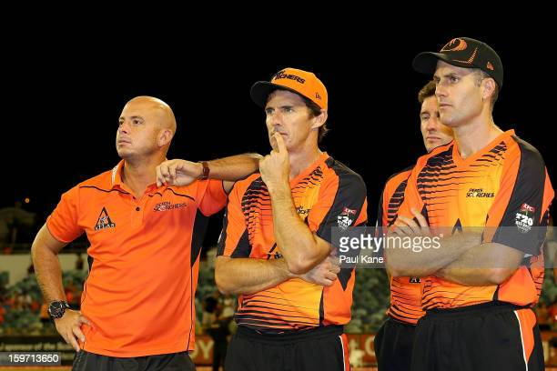 Herschelle Gibbs Brad Hogg and Simon Katich of the Scorchers look on after being defeated during the Big Bash League final match between the Perth...