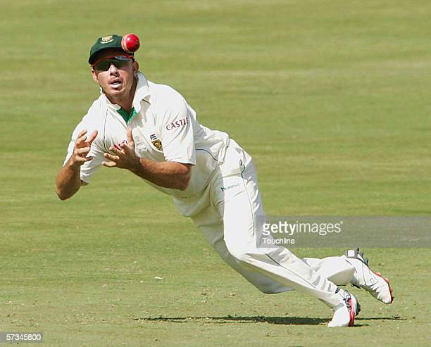 Herschelle Gibbs of South Africa catches Scott Styris off the bowling of Makhaya Ntini during day two of the first Test between South Africa and New...
