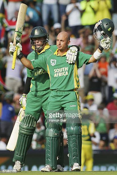 Herschelle Gibbs of South Africa is congratulated on his century by team mate AB de Villiers during the fifth One Day International between South...