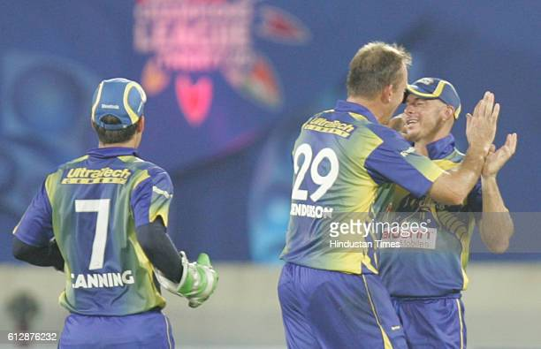 Herschelle Gibbs of the Cobras is congratulated after he caught Dimitri Mascarenhas of Otago during the Airtel Champions League Twenty20 Group C...
