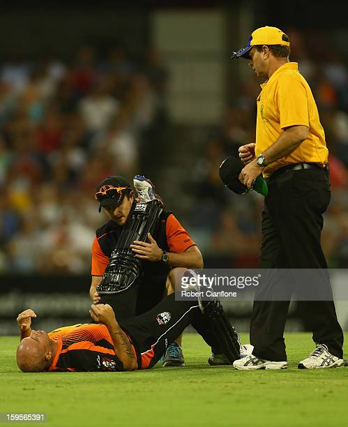 Herschelle Gibbs of the Perth Scorchers is treated for an injury during the Big Bash League semifinal match between the Perth Scorchers and the...