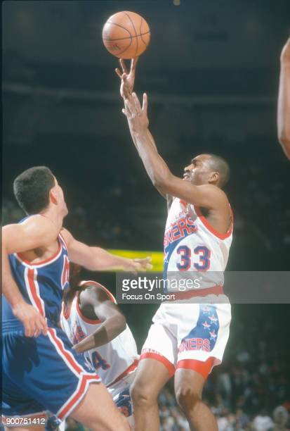 Hersey Hawkins of the Philadelphia 76ers shoots against the New Jersey Nets during an NBA basketball game circa 1992 at The Spectrum in Philadelphia...