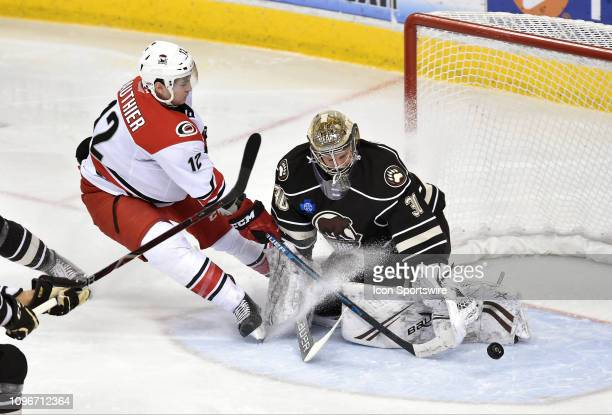 Hershey Bears goalie Vitek Vanecek makes a save on a shot by Charlotte Checkers right wing Julien Gauthier as Gauthier stops and sprays him in the...