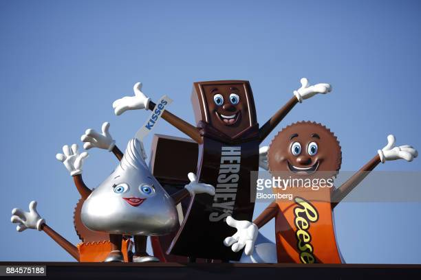 Hershey Co candy mascots stand outside of the company's Chocolate World visitor center in Hershey Pennsylvania US on Tuesday Nov 28 2017 Hershey...